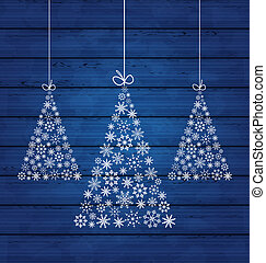 Holiday wooden background with Christmas pines made of...