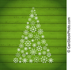 Christmas pine made of snowflakes on wooden background -...
