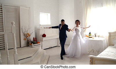Bride and groom dancing the first dance at their wedding day
