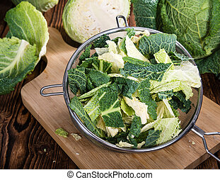 Savoy Cabbage (close-up shot) on wooden background