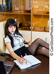 Beautiful woman working at the table in a office