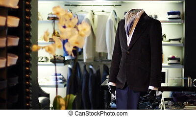 Men's jacket on a mannequin. Interior of the store....
