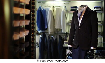 Interior of men's clothing store. Men's suits. Men's shirts....