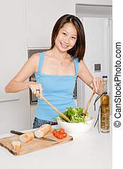 Woman Preparing Meal - A good looking woman preparing a...