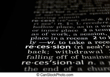 Recession Defined on Black - The word Recession in a...