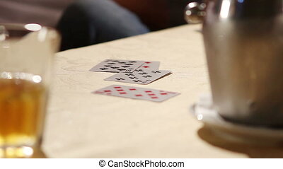 Men playing cards. Gambling. Cards on the table of the...