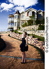 Lifestyle Of The Rich And Famous - A Wealthy Woman Standing...
