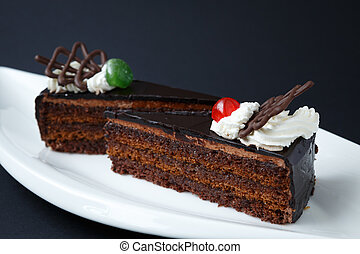 Sweet chocolate desserts on white plate
