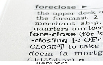 Foreclose Defined - Close-up of the word foreclose in a...