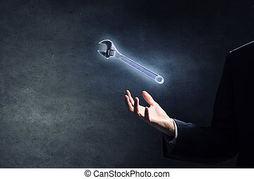Tools for your success - Businessman on dark background...