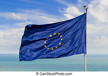 european union flag on a pole against horizon on water
