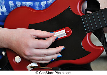 Playing Guitar Video Controller, blue fingernail polish
