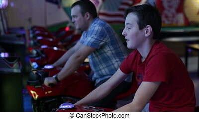 Man and teen ride on motorbike simulation game - Slot...