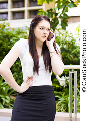 Unhappy Business Woman Talking On Cell Phone