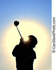 Silhouette of Teen Girl Swinging a Golf Club - Silhouette of...