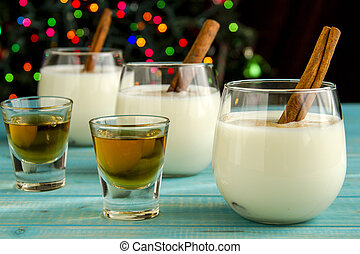 Festive Egg Nog with Cinnamon and Cookies - Row of small...