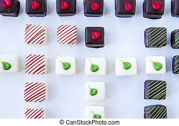 Assorted Petit Fours on White Background - Close up of...