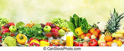 Vegetables and fruits over green background. - Fresh...