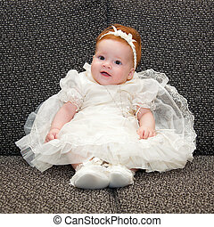 Baby in baptismal clothing - Portrait of a baby in baptismal...