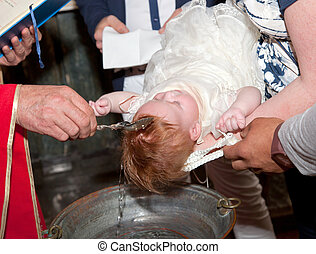 Christian baptism, the priest wetting child head.