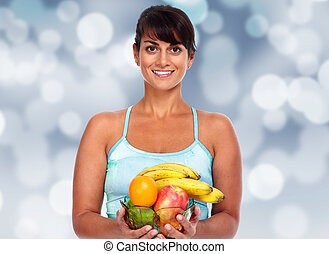 Young asian woman with fruits.