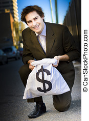 Happy Business Man Smiling With Money Bag - Happy Business...