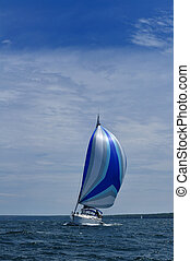 Sailboat with Blue Spinnaker Sail - Sailboat with blue...