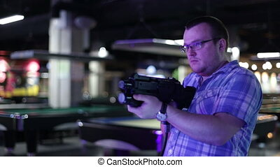 Man shoots from the gaming machine simulator - Man holding...