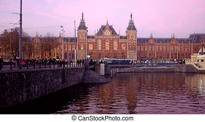 Central Station Amsterdam at sunset - Central Station at...