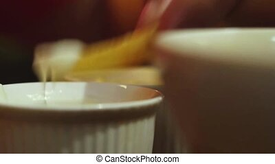 man eats french fries with cream close up of hands