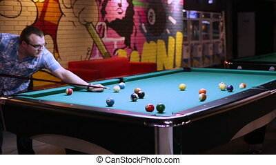 Young man playing billiard - Young man playing pool...