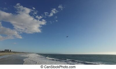 helicopter flies over the beach - SANTA MONICA, CA Wide high...