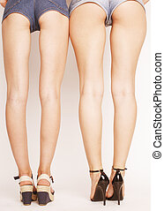 legs of young women with butts in jeans shorts - legs of...