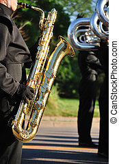 Marching Band Performer Playing Baritone saxophone in...