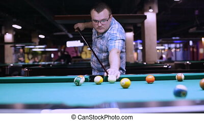 Man playing in pocket billiards - Young man playing pool...