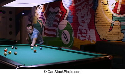 Adult man playing billiard - Young man playing pool...