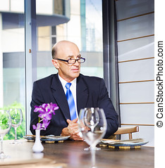 Senior Business Executive Attending Function A senior...