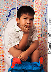 little asian boy defecate in toilet background