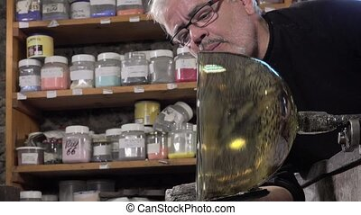 Glass-blower working - validation test of the size of the...