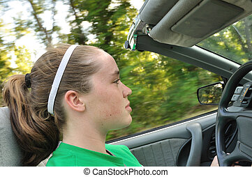 Teen Girl Driving a Convertible Car