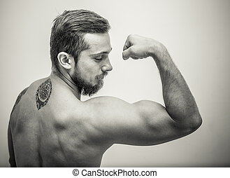 young and fit male model posing his muscles