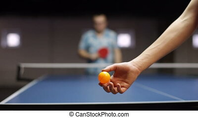 Young man playing pingpong - Adult sportsman playing table...