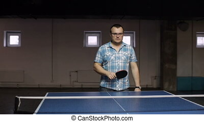 Man playing pingpong - Adult sportsman playing table tennis....