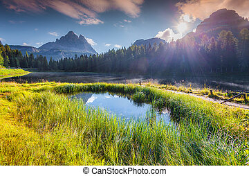 Suny summer scene on the Lake Antorno and Tre Cime of...