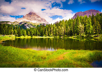 Suny summer scene on lake Antorno and Tre Cime of Lavaredo...