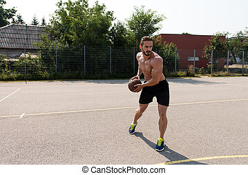 Bodybuilder Playing Basketball Outdoor - Basketball Player...