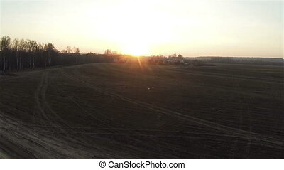 Aerial view of field roads at sunset in village, autumn, russian dacha