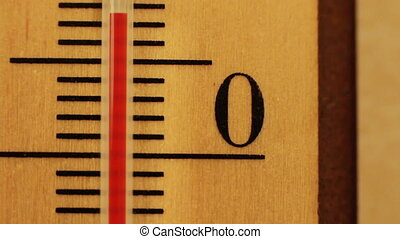 The temperature on the thermometer moves - Red mercury in a...