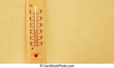 Temperature rising on a thermometer.