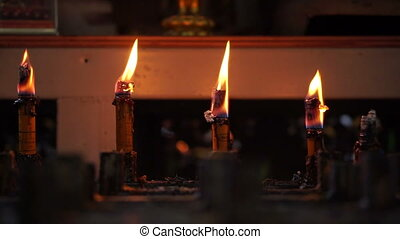 Candles burning in a temple Abstract step, level and faith...